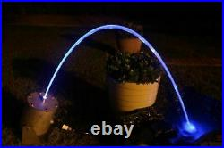 Water Jet Laminar Color LED Light stays inside a stream of water pool pond